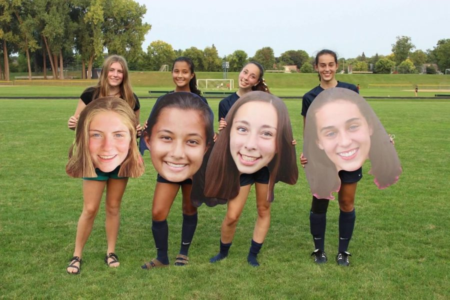 Each senior member (left to right), rin Magnuson, Izzy Medrano, Julia Baron, and Olivia Lagos, got a sign, flowers, and a special introduction to the fans, including their best moments from soccer, their favorite hobbies, and what they're looking forward to in the future.