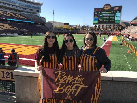 Here, LeMinh (far right) is at a Gophers game with her two sisters.