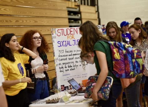 Students in years passed walk from booth to booth to talk to club representatives and find what club interests them.