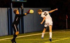 Junior Jack Hlavka heads the ball into Blake's goalie's hands.