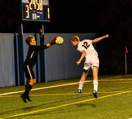 Junior Jack Hlavka heads the ball into Blake's goalie's hands.