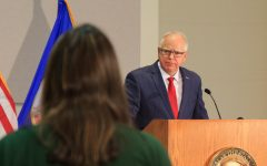 During the Oct. 2 Governor's Student Press Summit in St. Paul, MN, Senior Annika Rock of St. Paul Academy and Summit School's RubicOnline asks Minnesota Governor Tim Walz about elementary students' return-to-school plan in the COVID-19 era. Photo by Nikolas Liepins.