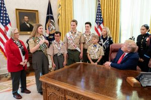 Tunney represents Boy Scouts of America in a meeting at the Oval Office.