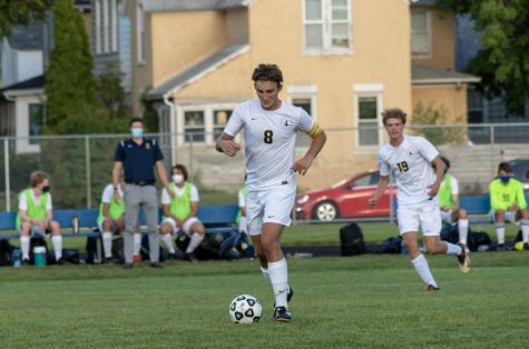 Senior Michael Bagnoli dribbles the ball.