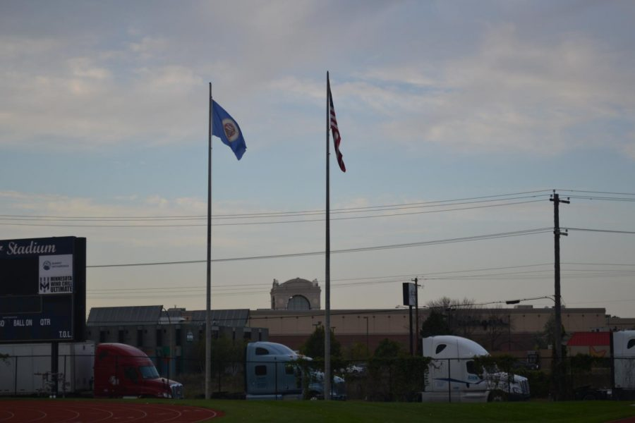 The Minnesota and United States flags fly over Sea Foam Stadium at Concordia University. SPA does not fly a Minnesota flag on it's flagpole.