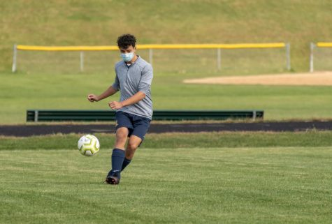 Senior defender Anthony Chen warms up following COVID-19 protocols.