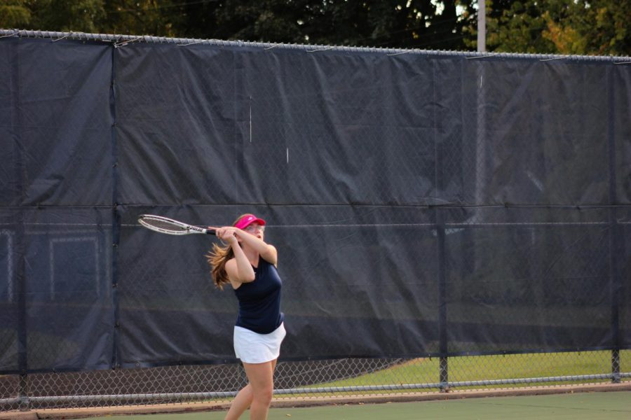 Sophomore Ali Browne returns a ball during her singles match.