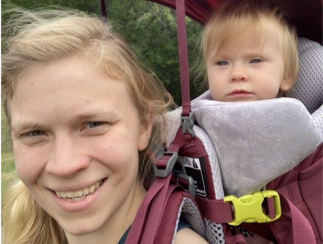 Photo submitted by Anne Boemler, US English teacher of her with her baby in a hiking carrier.