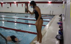 Junior Divya Bhargava cheering for a teammate during a meet in 2020.