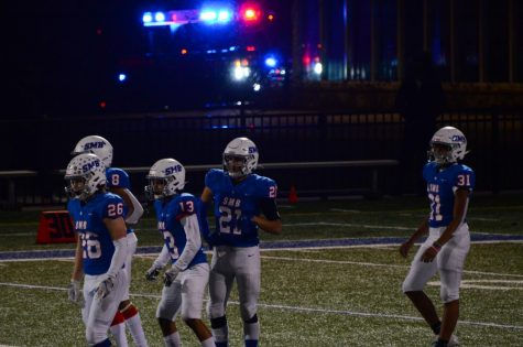 Wolfpack players rush back to the field after a player gets injured.