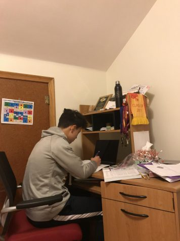 Sophomore Benjamin Chen personalizes his desk to make it accessible for both school and studying.