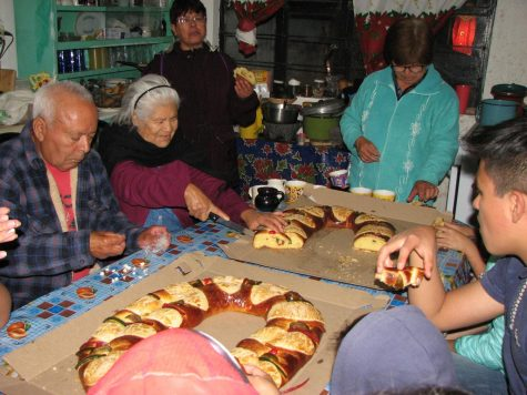 Rosca de Reyes is a large donut shape oval bread with little plastic baby Jesuses stuck inside. Whoever cuts into the baby Jesus has to make food for the next celebration.
