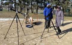 US science teacher Steve Heilig and a student observe Mercury's transit across the sun last year. Star parties have still been able to happen this year with the addition of safety measures like masks, goggles, and social distancing.