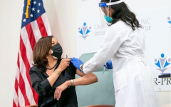 Vice-president elect Kamala Harris receives the first dose of the COVID-19 vaccine in front of press.