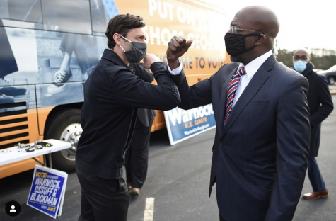 Winners of the Georgia Senate runoffs Jon Ossoff (left), and Raphael Warnock (right), celebrate their victories together.