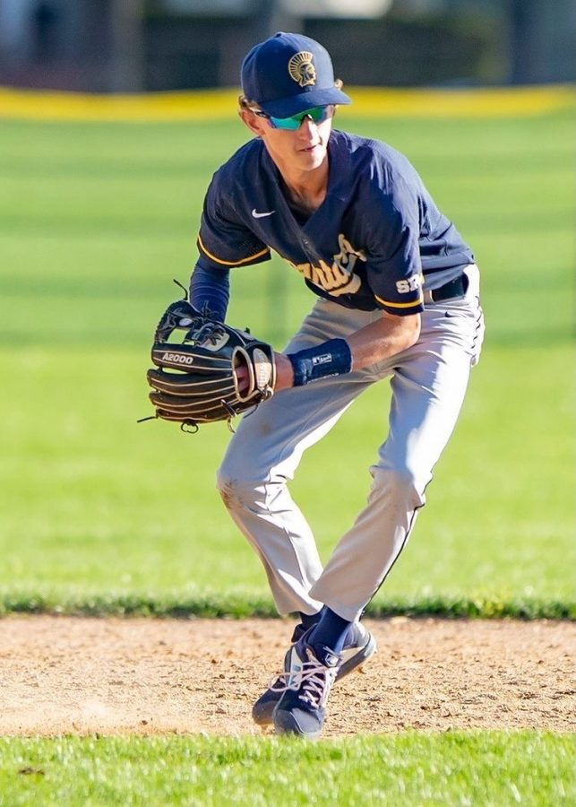 Junior Boden Strafelda throwing the baseball.