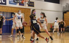 Sophomore Lindsay Browne sets a screen to create an open shot for fellow teammate Naomi Kempcke.