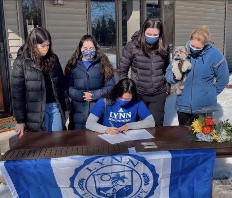 Senior Jasmine White signs the official document to swim for Lynn University.