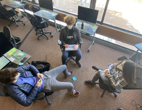 Ibid yearbook editors Levi Smetana, Eddie Gamble, and Leona Barocas work on a team storytelling activity to prepare for feature assignments in the winter section of the 2021 yearbook.