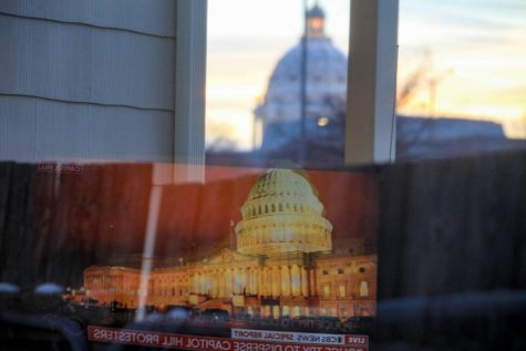 The U.S. Capitol news coverage on January 6 reflected with the Minnesota State Capitol.