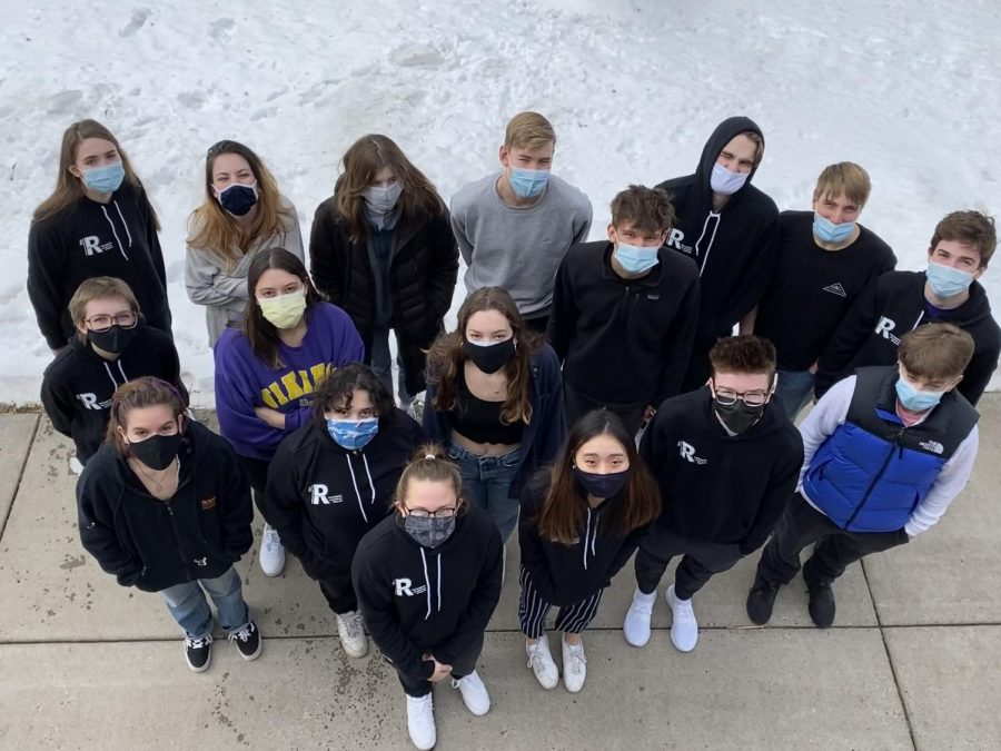 RubicOnline staffers model their publications sweatshirts outside in January (brrr).