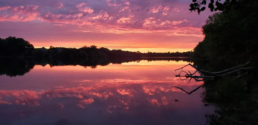 With beautiful clouds rolling in the sky, the sunset turns the lake into an ombre of purple, to pink, and to orange.