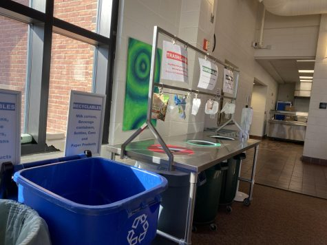 The current setup in the lunchroom contains a recycling bin, as well as one trash can, and two compost bins.