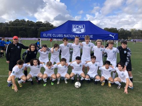 Junior Leo Larsen poses with his Minnesota Thunder Academy soccer team at a showcase in Florida.