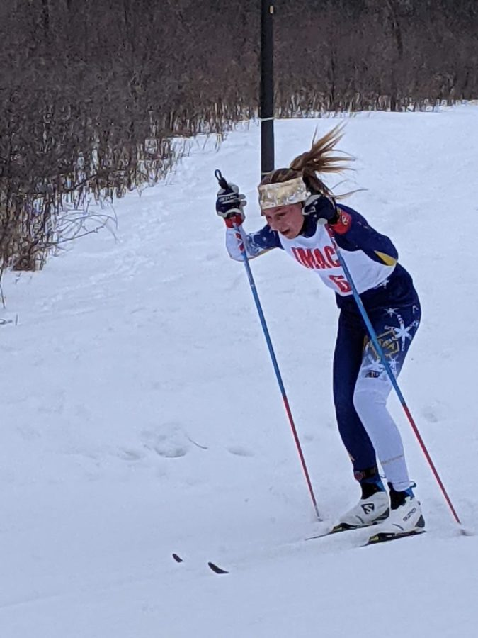 8th grader Igna Wing skis during the section tournament.