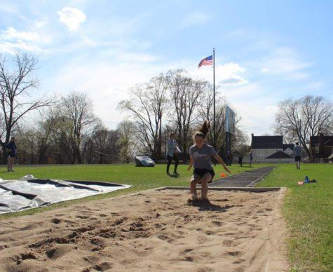 Insley Graupman lands her long jump.