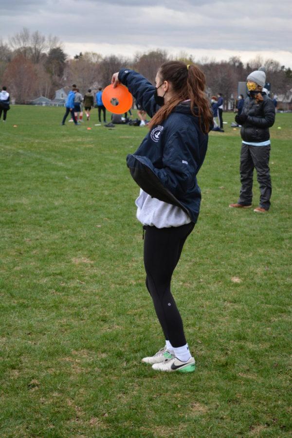 Senior Julia Baron prepares to toss the frisbee during a practice.