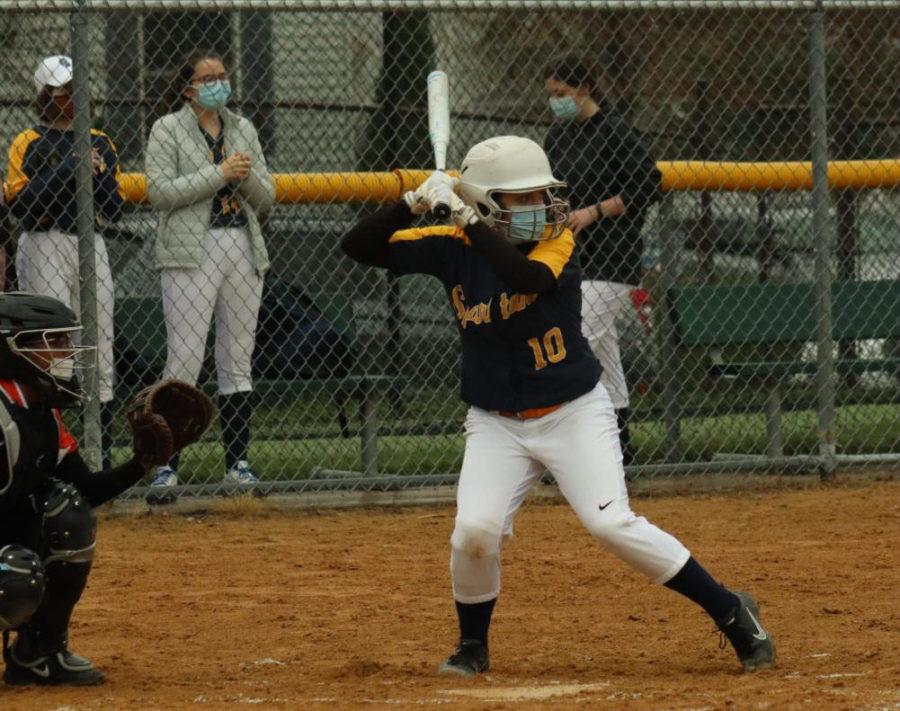 During their game, Sophomore Greta Magnuson prepares to take a pitch.
