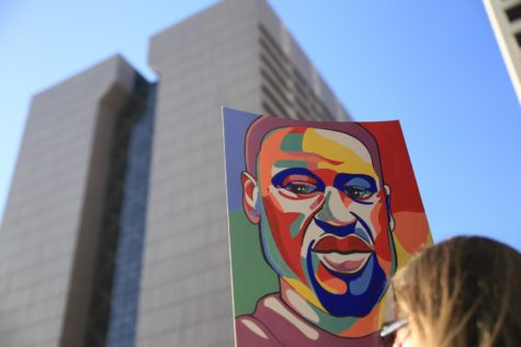 A portrait of George Floyd held up in front of Government Center in Minneapolis, MN.