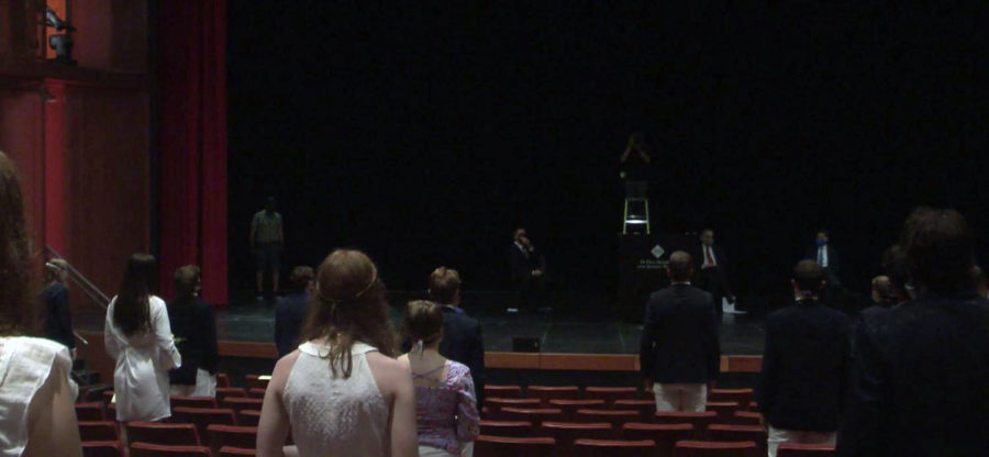The 2020 Commencement moved inside the Huss Auditorium due to bad weather. Their families were situated across campus at various spaces were set up to live stream the ceremony.