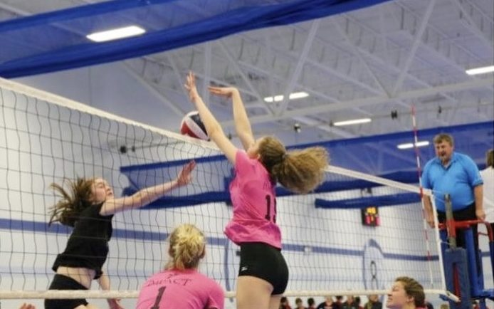 """Sophomore Solvej Eversoll goes up for a block during a club volleyball game. """"Over the summer I plan to help out more at more of the fifth-grade clinics and there may be a camp that SPA is running and if so I hope to volunteer,"""" she said."""