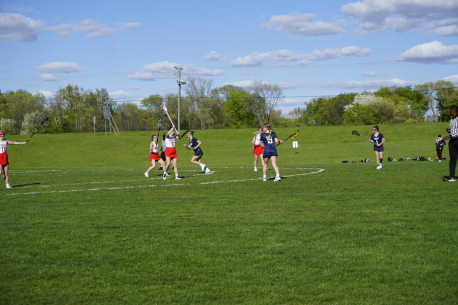 The Visitation team defends their goal as St. Croix Prep prepares to score their 3rd goal.