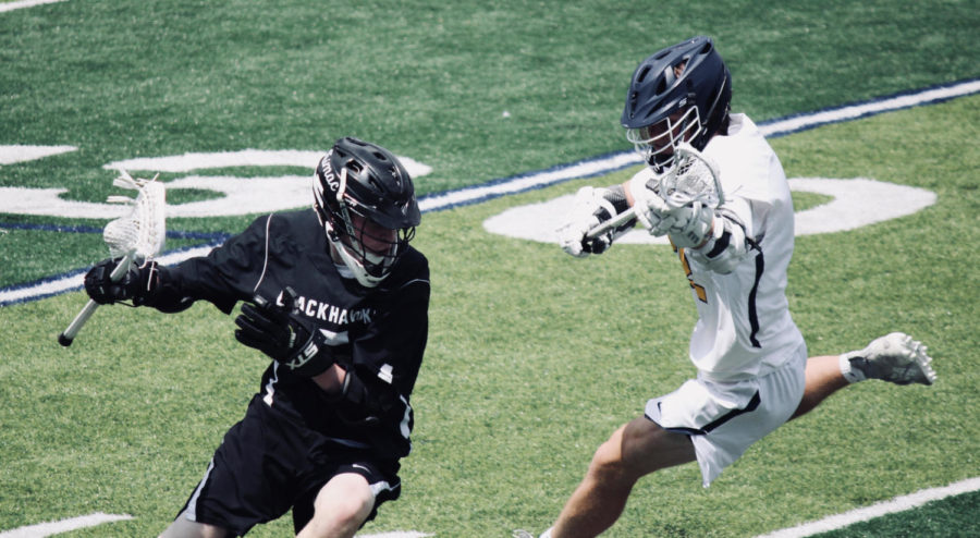 """O'Brien plays on both the JV and varsity lacrosse teams, two quarters on JV and four on varsity. """" I enjoy getting to play for both teams since more playing time equals more time to improve and better your technique along with meet[ing] people from both of the teams,"""" O'Brien said."""