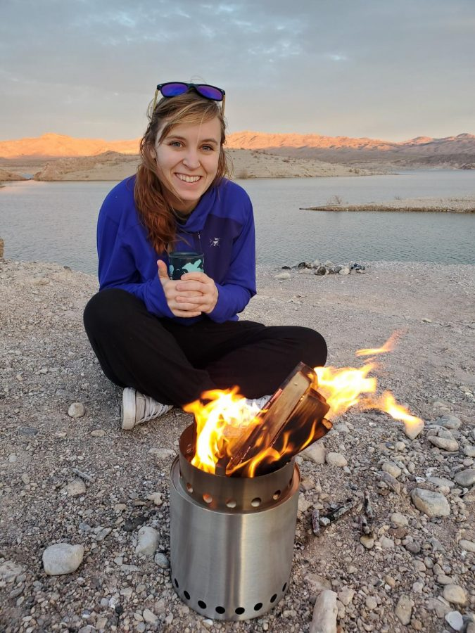 Mckenna Shaw camping on a cold morning by her stove.