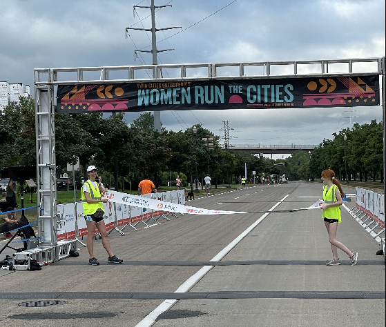 Kate Jacobs assisting setting up the finish line for the Women Run In the Cities marathon. Jacobs had helped the runners for a morning.