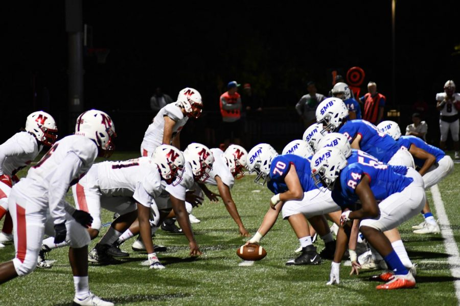 """LINE OF SCRIMMAGE. SMB Wolfpack starts a play in a heated match with North St. Paul Sept. 10 that ended in a 48-20 win for the pack. """"I feel like this year we've had a lot more time to connect and become a team,"""" quarterback Connor Overgaard said."""