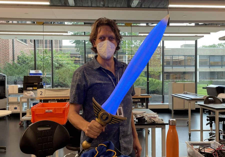 Huebner shows off his homecoming sword. The sword has flashy light affects that dance in different patterns.