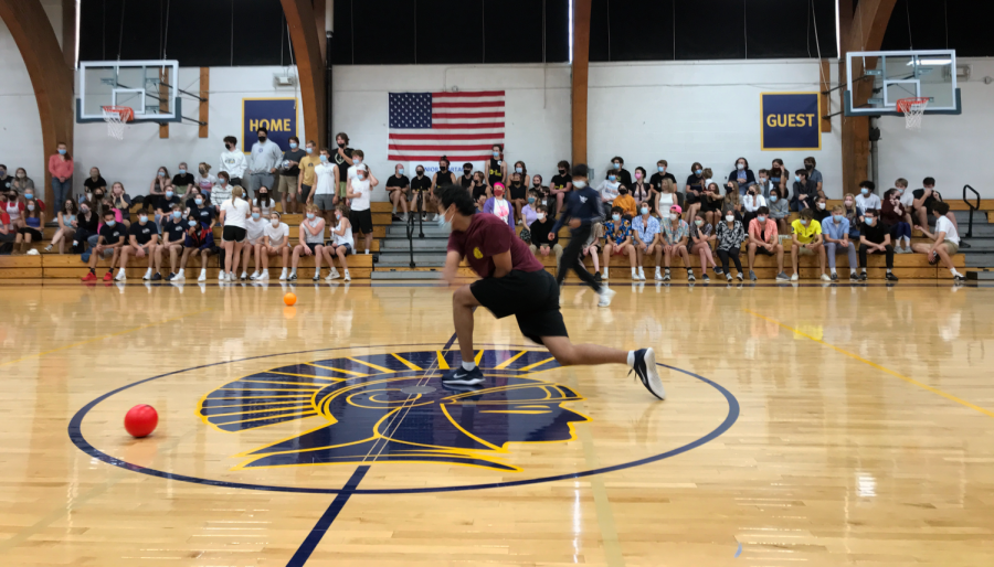 Junior Tenzin Bawa lunges for a powerful shot at an opponent.