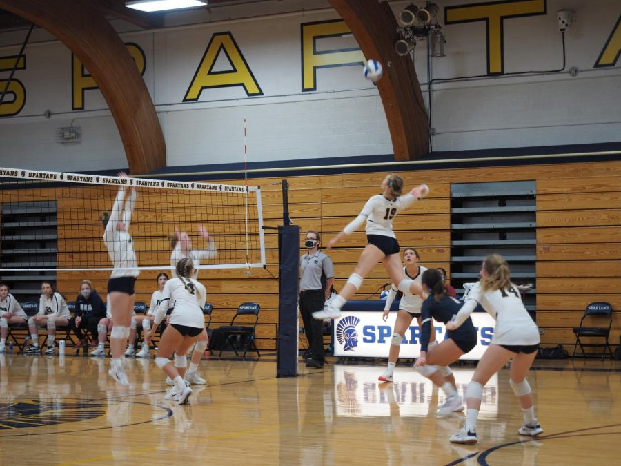 Solvej Eversoll jumps up for a spike.