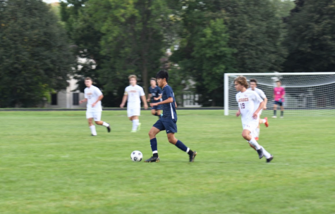 Sophomore Orion Kim receives the ball and dribbles up the field.