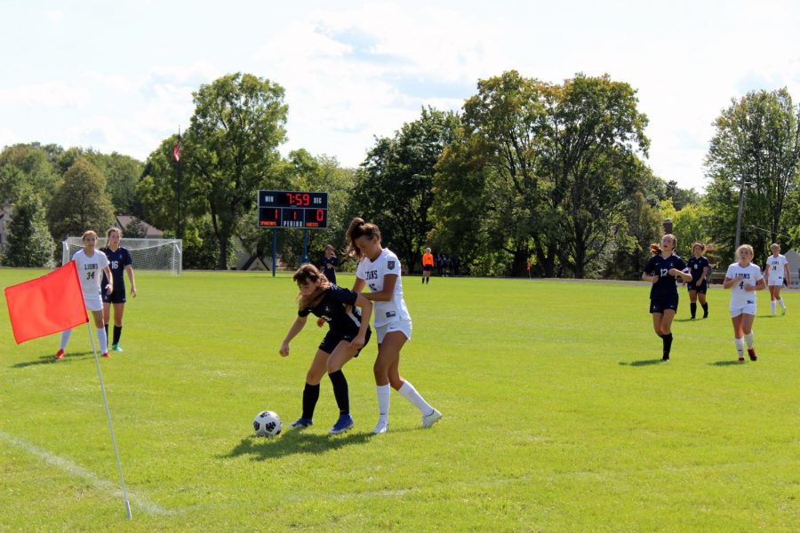 Midfielder Clare Ryan Bradley fights for possession against a Providence defender.