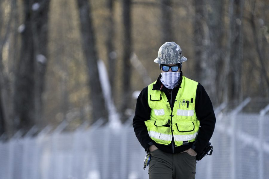 An Enbridge Line 3 construction worker walks on-site in Aitkin County, MN.