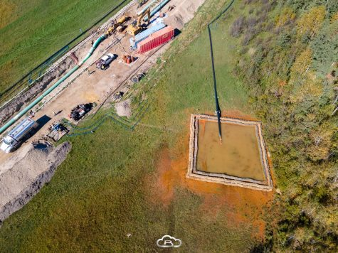 Enbridge holds wastewater in a makeshift pool which allows the contaminated water to runoff into the local prairie and woods, while they pump it to another location.