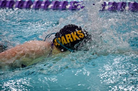 Senior Marie Schumacher swims her first inidividual event of the night which is the 200 freestyle.