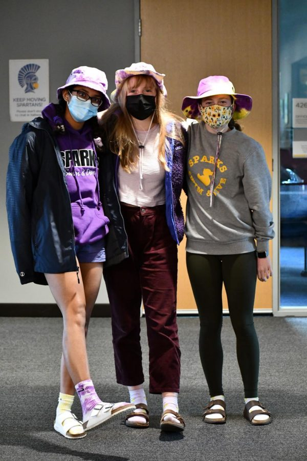 From head to toe, seniors Divya Bhargava, Eleanor Smith and Marie Schumacher purple out.
