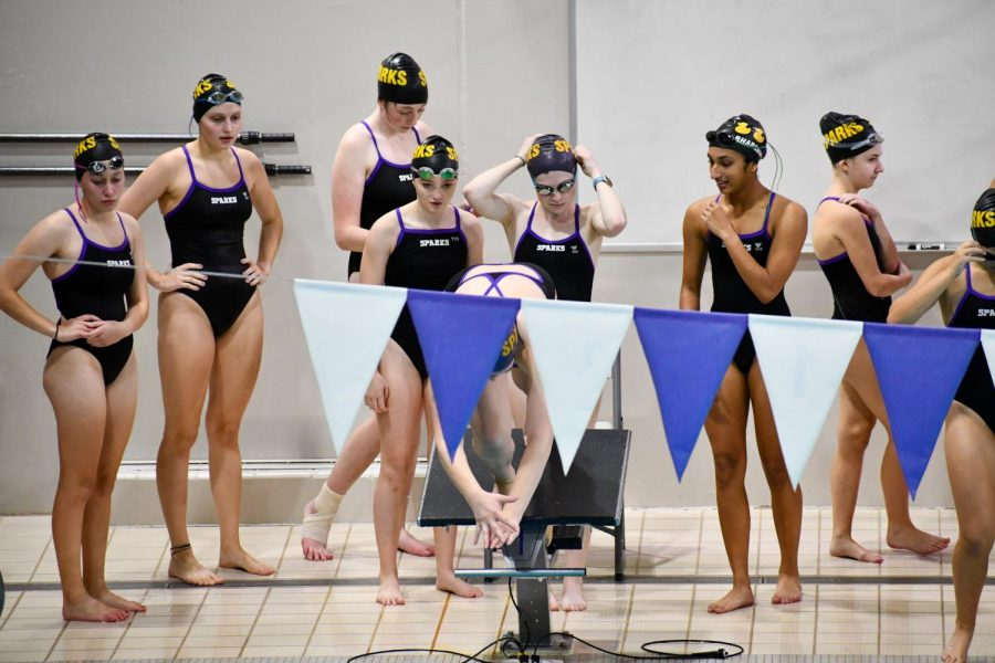 The varsity girls prepare for their first relay of the night, the 200 Medley.